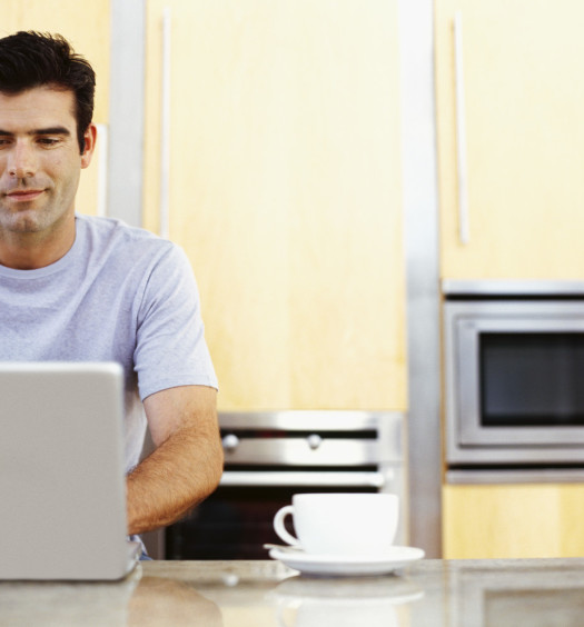 mid adult man using a laptop